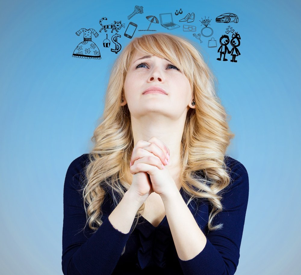 Closeup portrait of sad, funny looking young woman, praying, dreaming, thinking, wishing, hoping, asking, begs for best in life isolated blue background. Emotion, facial expression, feelings, attitude.jpeg