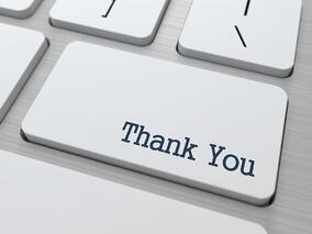 Thank You Button on Modern Computer Keyboard with Word Partners on It..jpeg